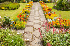 Garden landscaping with a path royalty free stock image