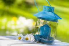 Garden lantern. With daisy flower stock photo