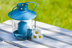 Garden lantern. With daisy flower stock photography