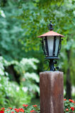 Garden lantern of an old wooden beam Royalty Free Stock Photography