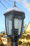 Garden lantern in the patterns from frost. In Russia Stock Photos