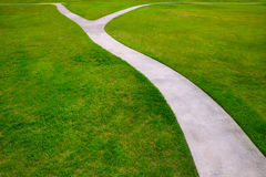 Garden lawn grass with a two option ways detour. Metaphor of which way to choose Stock Photos