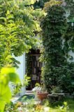 The garden library. Library seen through the foliage of an enchanting garden stock photography