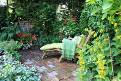 Garden lounge chair royalty free stock photo