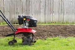 Tiller Machine for Garden. A garden machine tiller with nobody in shot Stock Image