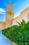 The garden and medieval walls Royalty Free Stock Photos