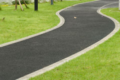 Garden for morning exercise. A pathway for jogging or walking in a park Stock Photography