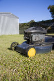 Garden Mower. Sits In A Backyard On Freshly Cut Green Grass Stock Images