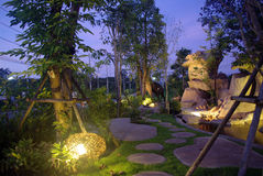 Garden at night with waterfall Royalty Free Stock Photo