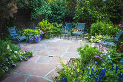 Garden Nook. Photograph of a secluded nook in a large ornate garden Stock Photos
