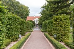Garden at the Oliwa Park. Formal garden and building at the Oliwa Park Park Oliwski. It`s a public park in Gdansk, Poland Royalty Free Stock Photography