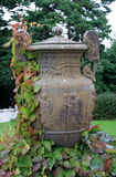Garden Ornament. A garden ornament is an item used for garden decoration. The category can include fountains, statues, sundials, masks, chimes, weathervanes Stock Photography
