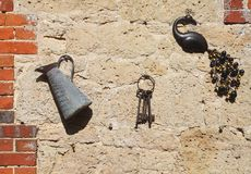 Garden Ornaments. Hanging on a Wall Royalty Free Stock Image