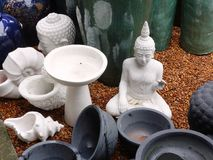 Garden Ornaments. A range of garden ornaments, including white Buddhas and ceramic bowls or pots Stock Photos