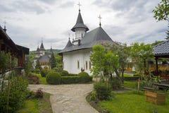 Garden at orthodox monastery of Sihastria. Flower garden of Sihastria monastery in Moldavia Royalty Free Stock Photo