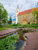 Garden of Our Lady of Hungary Church in Keszthely town. Picturesque public garden of Our Lady of Hungary Church in Keszthely town, Hungary; with small pond on Stock Photo