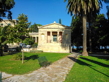 Park in Corfu, Greece. Park bench on grass lawn in Corfu, Greece Royalty Free Stock Images