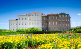 Garden and palace facade - Reggia di Venaria. Reggia di Venaria, Italy - Park, flowers and castle Royalty Free Stock Image