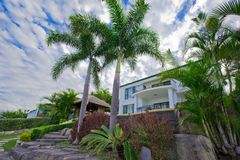 Garden with palms and Bali Hut Stock Images