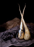Garden parsnips. With knife in black background Stock Photo