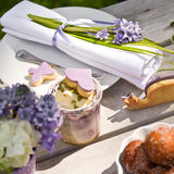 Garden Party. Table decoration in spring with fresh flowers Stock Image
