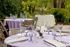 Garden party. Garden set up for a outdoor party, tables with dessert table in the background Stock Image