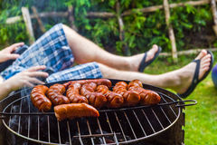 Garden party roasted sausages grill Stock Images