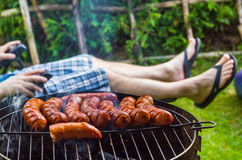 Garden party roasted sausages grill Royalty Free Stock Images