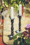 Garden party setup. Cast iron candle sticks and champagne gasses. Garden party concept Stock Photos