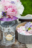 Garden party table: box of sweets and bouquet of flowers Stock Photography