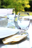 Garden party table. Glass table prepared for a summer garden party Royalty Free Stock Photo