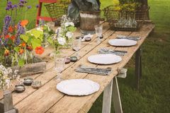 Garden party table. Wooden table setup for garden party or dinner reception Royalty Free Stock Image