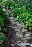Garden Path. Stone path through a verdant garden Royalty Free Stock Photo