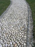 Garden path. Close up view of the nice beach stone walk way stock photos