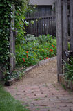 Garden path. Rustic old romantic garden path through a gate into a garden Stock Images