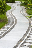 Garden path. Curved path in a peace garden royalty free stock photography