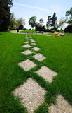 Garden path. Garden stone path with green grass royalty free stock photography