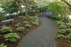 Garden path. Curvy Garden path with trees Stock Images
