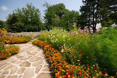 Garden path. Garden stone path with flowers Royalty Free Stock Photography