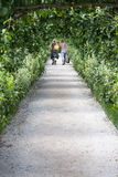Garden Path. Two women walking along a garden path, space for text royalty free stock photos
