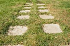 Garden path across grass Royalty Free Stock Image