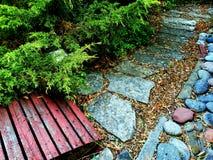 Garden path. Flagstone path in a garden with an old bridge Stock Photography
