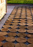 Garden path from impregnation wood. Garden idea for wooden path around the house made it from circle wood Stock Image