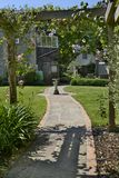 Garden path leading to house Stock Photos