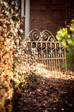 Garden path leading to iron gate Stock Image