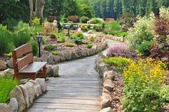 Garden path. Through garden or park with young plants Royalty Free Stock Photos