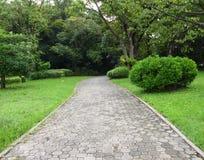Garden path walk in public park Stock Image