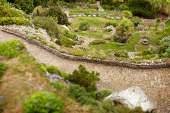 Garden path wishing well Royalty Free Stock Image