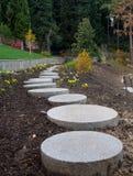 Garden paths made of circular stone slabs Stock Photo