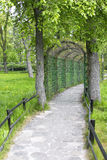 Garden pathway with green arch Stock Image